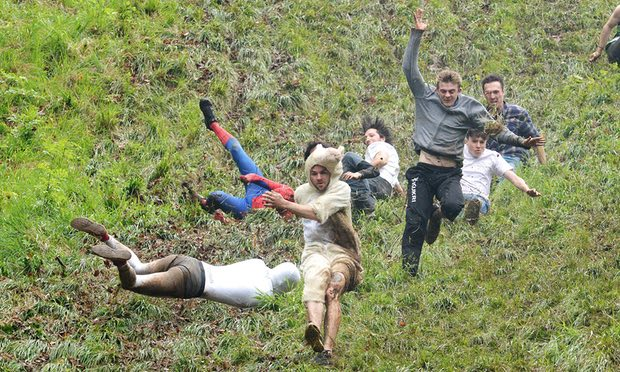 Cheese rolling in Gloucestershire: 'foreign observers need look no further to understand the mentality that drove us to embrace the vertical cliff of Brexit'. Photograph: Ben Birchall/PA