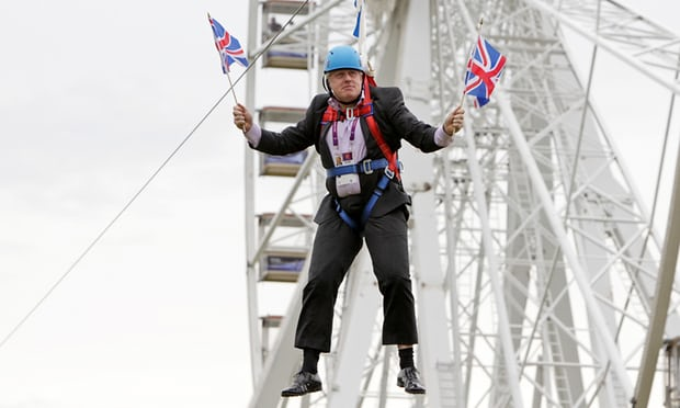 Johnson in traditional pose, stuck on a zip wire. Photograph: Barcroft Media