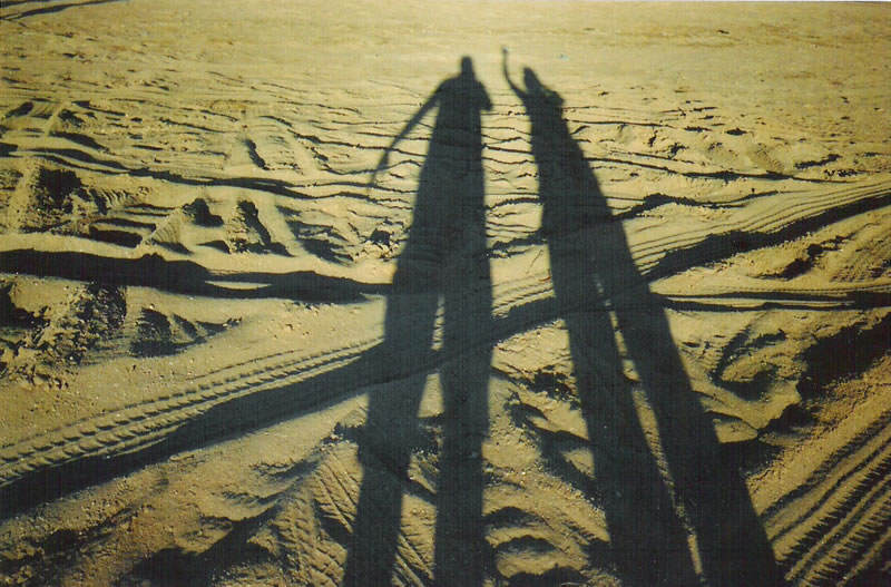 May 2005 - The shadows of Me and our tour manager Edwina Lunn in the Great Western Desert, Australia.